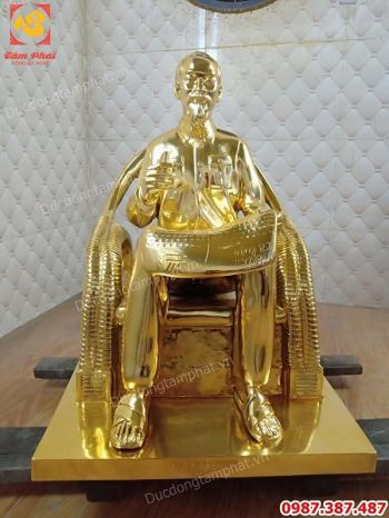 Tượng Bác Hồ ngồi đọc báo nhân dân xã luận cao 60cm mạ vàng 24k..!